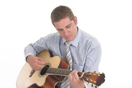Young lad playing his little yellow guitar over white photo