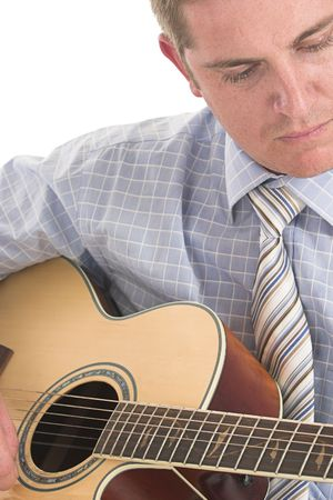 Close up of businessman playing guitar over white photo