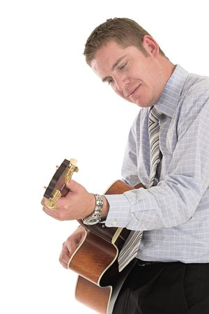 Businessman relaxing playing his old guitar over white Stock Photo - 603274