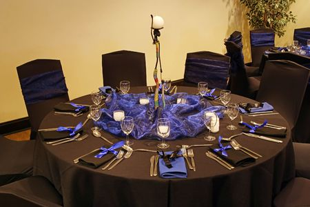 catered: Black table setting in a african theme