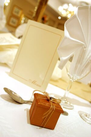 Little boxed gift on a wedding table Stock Photo