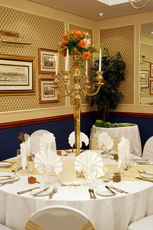Dinner table setting at a banquet with roses on a chandelier Stock Photo