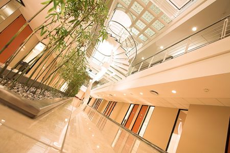 lucrative: Office Building interior with spiral staircase Stock Photo