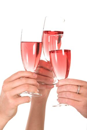 Three woman toasting over a glass of bubbly