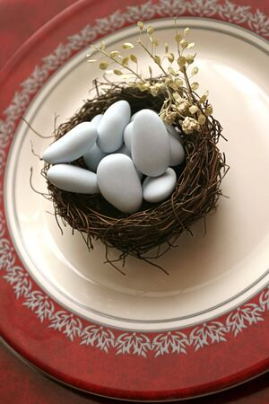 Eggs in the nest set as favors on a dish