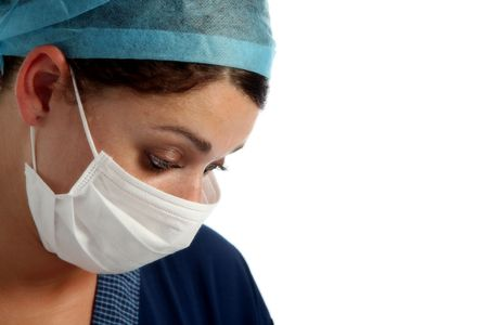 Serious looking nurse with cap and mask Stock Photo - 705153