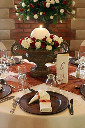 Wedding table setting with white and red roses photo