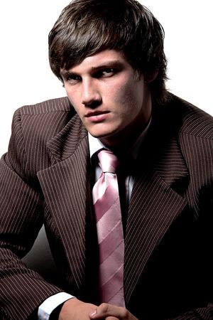 Male model posing in the corner wearing a suit 4