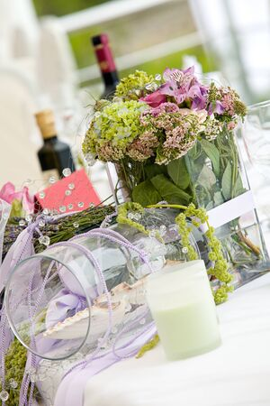 Wedding table arrangement with flowers and wine