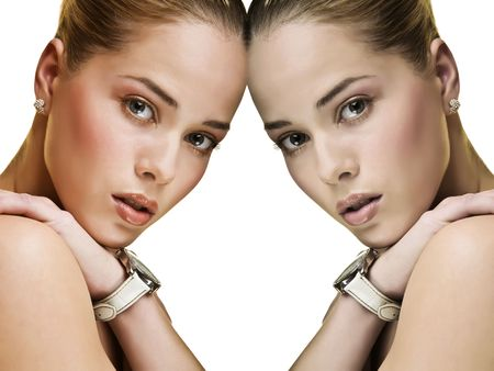 Mirror image of a atractive young woman with stylish makeup wearing a white stap wrist watch.
