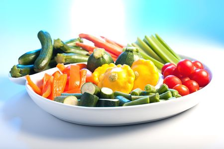 veg: Selection of fresh veg on a spiral white plate.