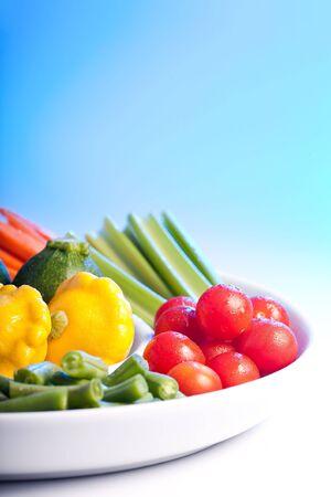 veg: Selection of fresh veg on a spiral white plate.