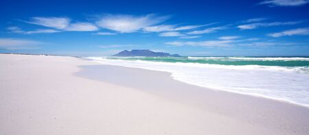 Beautiful landscape of Table Mountain taken from the white sandy beach off Blaauberg. photo