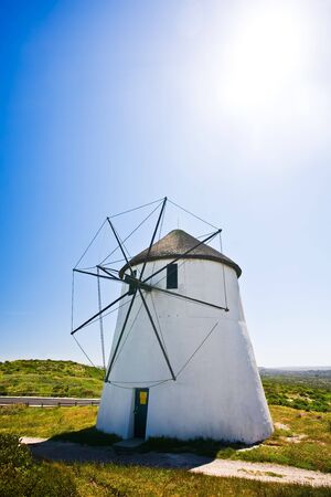 A frontal view of a windmill in action on a sunny day. Stock Photo - 6716535