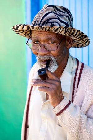 Old man smoking his pipe photo