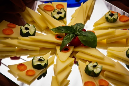 Cheese platter with carrots and cucumber  photo