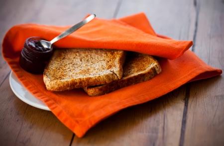 Toast with jam and orange servet