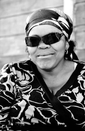Grandma posing with her sunglasses to th photographer. photo