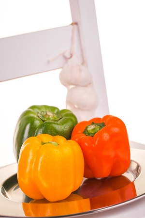 Green, Orange and red peppers in the studio with three garlics Stock Photo - 14309376