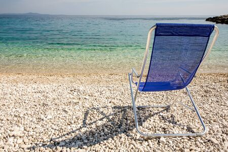 adirondack chair: A laid back and crystal clear day on the waters of Croatia. Stock Photo