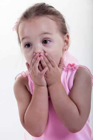 The little girl in the pink dress is very shocked about what she saw Stock Photo - 14563870
