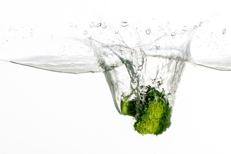 restuarant: Broccoli in water thats fresh and there to clean the vegetable  Stock Photo