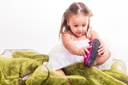 gmph, these shoes are always a hassle, just going to take them off. Stock Photo