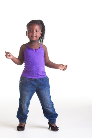 The little is dancing in the studio on the beat of the music.