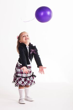 Birthday girl playing with her balloon. photo