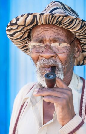 After tuff years, smoking his pipe is the highlight of the day. Stock Photo - 14966701