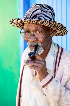 Old man smoking his pipe Stock Photo - 14966718