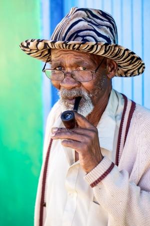 Old man smoking his pipe Stock Photo - 14966718