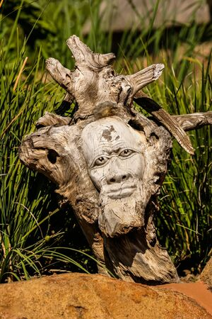 crafty: Wooden art with a crafty face.