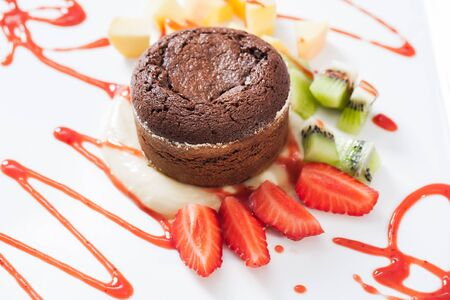 souffle: Chocolate souffle served with strawbeeries and pineapple.