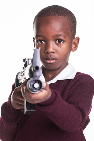 Small children with guns in school: Dangerous or scared? photo
