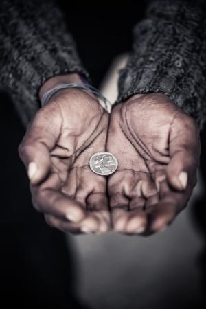 old beggar: The humans hunger for money.9