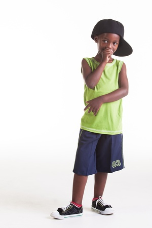 The rapper child in the studio with his rap clothes. photo