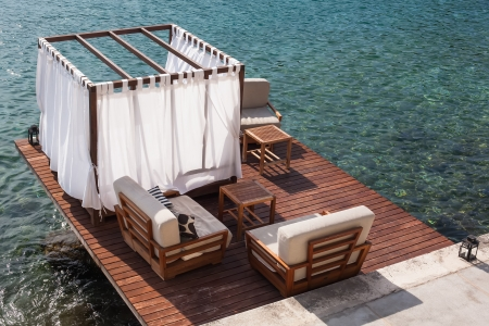 pool deck: Bead and lounge situated on a deck on the beach. Stock Photo