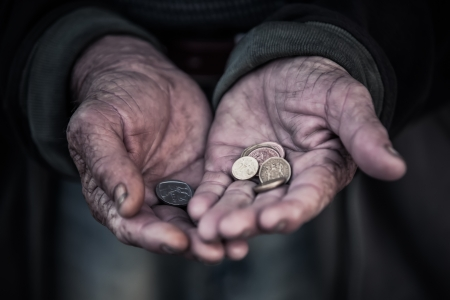 The man is begging for money, because of hunger. Stock Photo