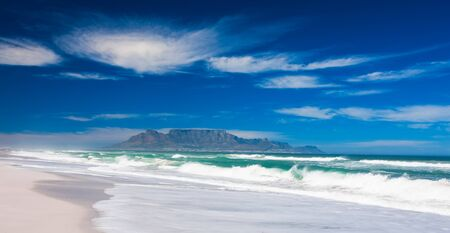A crystal clear day in the beach in Bloubergstrand. photo