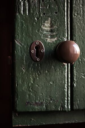 Old door knob and a grunge old painted door. photo