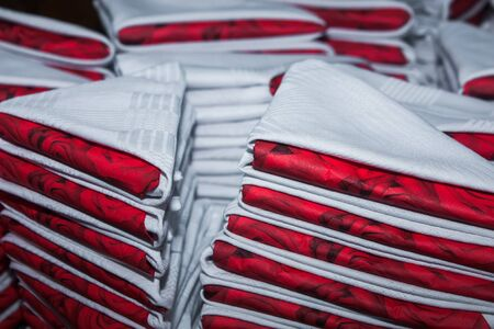 serviettes: About 200 white and red serviettes with roses are done.
