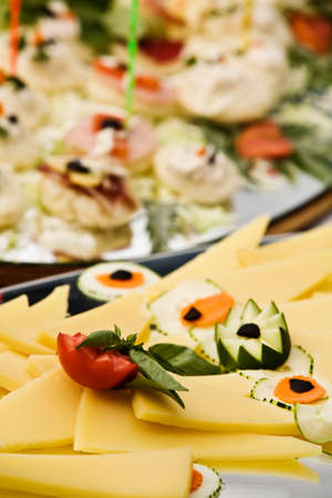 Cheese platters is served with cucumber and tomatoes. photo