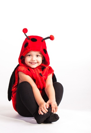 lady bug: Lady bug with lots and lots of big black dots. Stock Photo