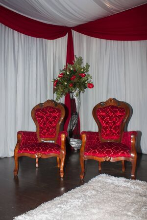 Vintage chairs on the stage for the two special people. photo