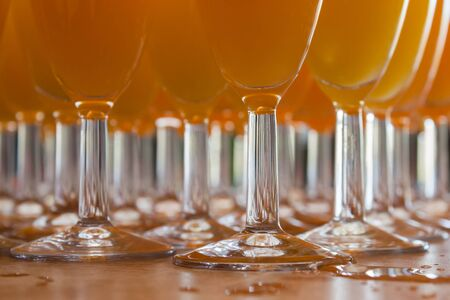glance: Many juice glasses with a  crystal glance. Stock Photo