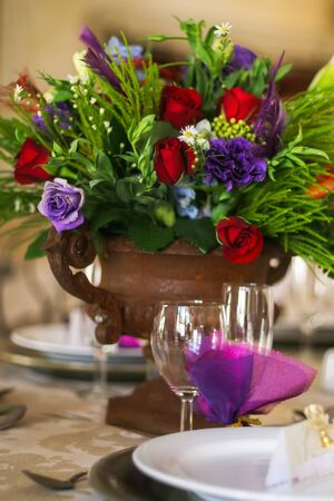 The center piece on the table at the venue of a function. photo