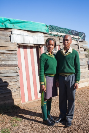 south african: Two diverse teenager from the shacks after school.