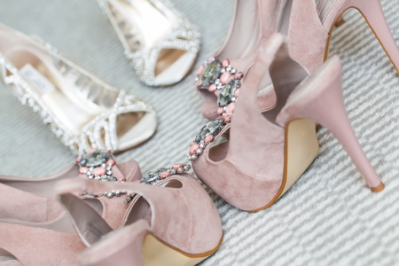 wedding accessories: The bride and her bridesmaidss shoes being photographed Stock Photo