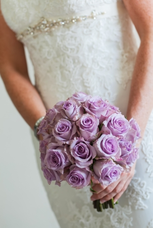 purple dress: Purple rose bouquet for the bride on her special day.
